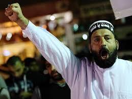 Photo du preneur d'otages trouvée sur le site de propagande islamiste qu'il animait
