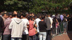 files de migrants