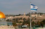 """An Israeli flag flutters on the roof of a buiding of the Jewish Quarter in the Old City of Jerusalem opposite the Dome of the Rock (L) in the Al-Aqsa mosque compound, on December 5, 2017. The EU's diplomatic chief Federica Mogherini said that the status of Jerusalem must be resolved """"through negotiations"""", as US President Donald Trump mulls recognising the city as the capital of Israel. / AFP / THOMAS COEX"""